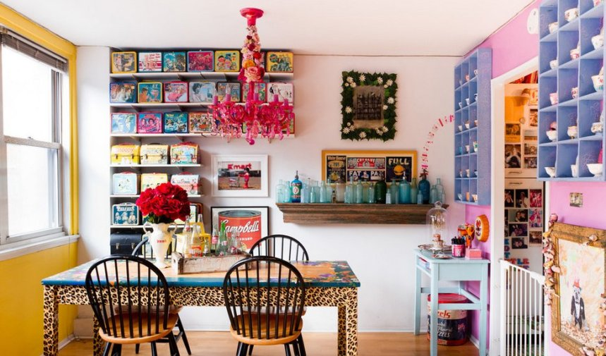 maximalist-kitchen-animal-patterned-table-art-boxes-on-statement-wall-collection-of-glass-vases
