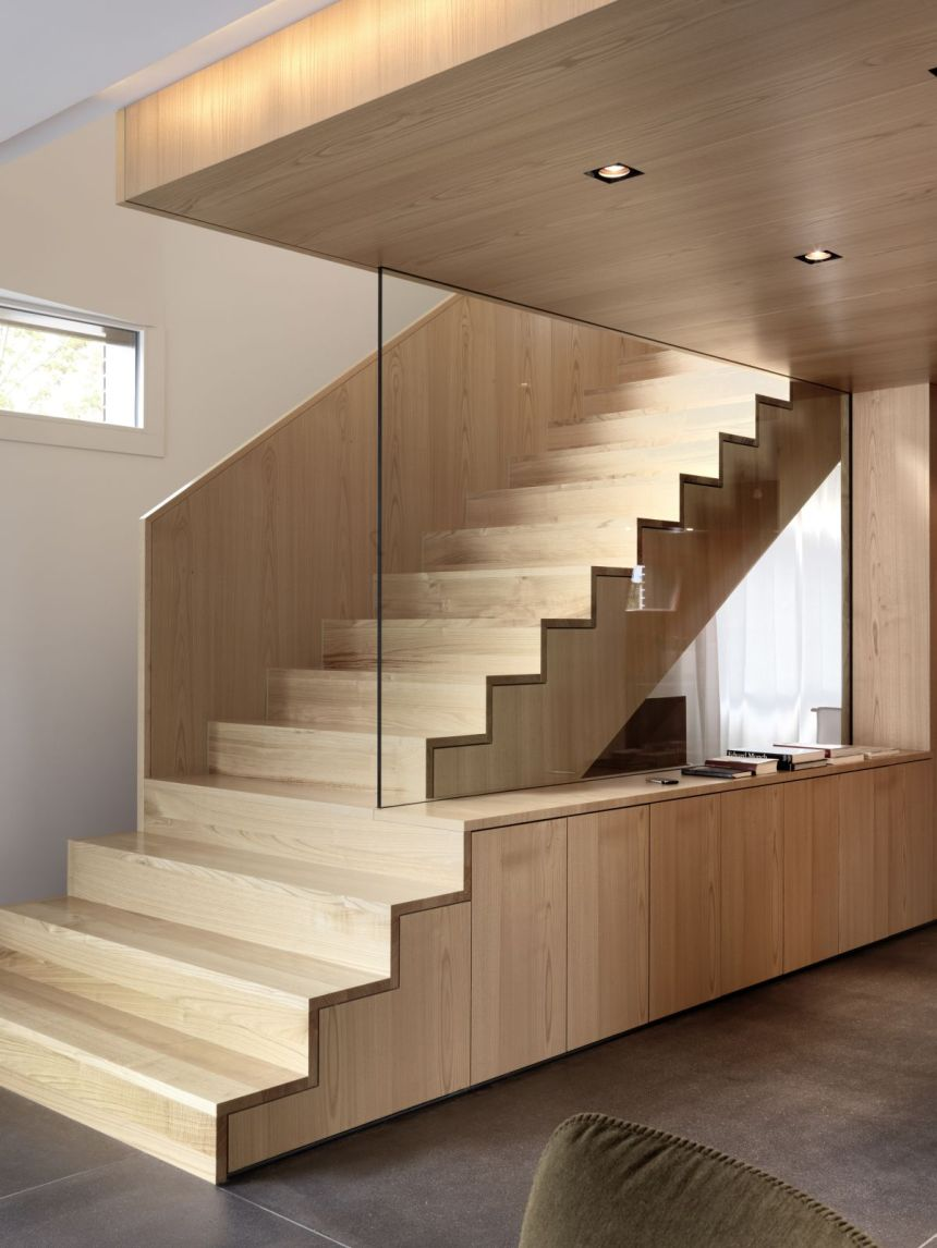 Interior-Design-with-maple-wood-staircase-design-and-clear-glass-railing-and-grey-concrete-floor